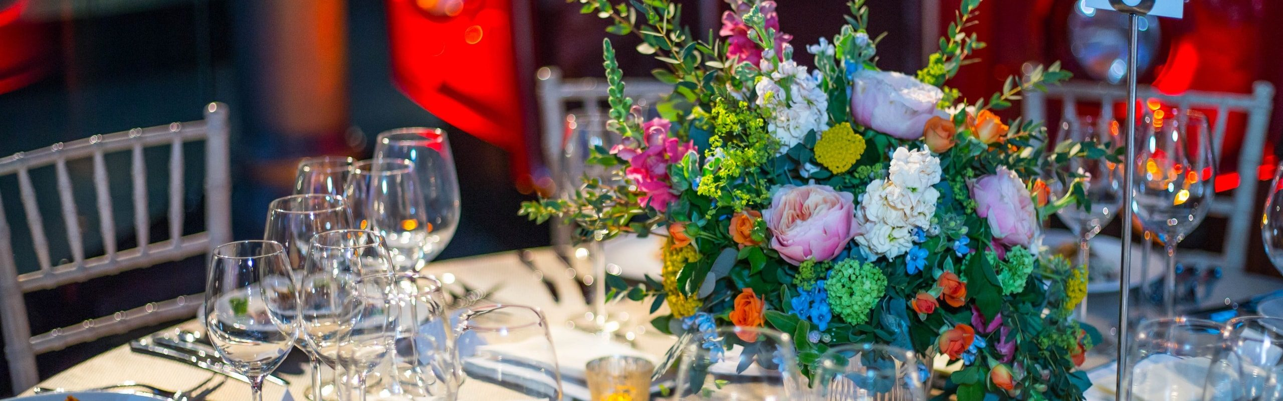 flowers and glasses at the table