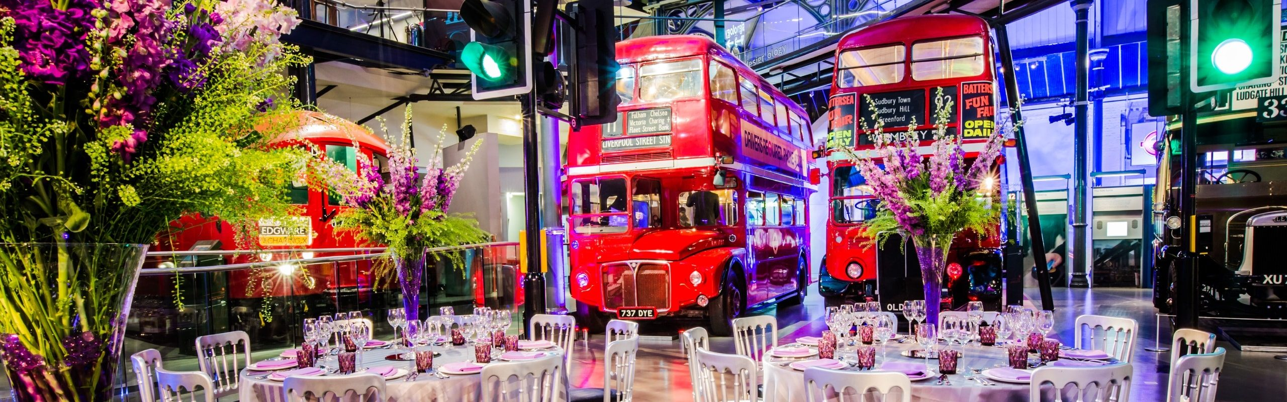 tables surrounded by red buses